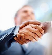 handshake in an interview, we see just two hands in business outfit, a firm shake of them